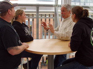 Lane Community College Energy Management Program Coordinator Roger Ebbage talks with students